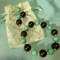 3 piece jewelry set Really pretty Aqua and black bracelet and earrings set. They come to you in a super cute light Aqua bag. MIME Jewelry