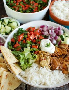 Take your weeknight meals to a new level with these Chicken Shawarma Rice Bowls. These simple to make rice bowls will take you away to the Mediterranean and are packed with healthy and delicious ingredients. Basmati rice is topped with chicken shawarma, tabbouleh, red onion, hummus, yogurt and lettuce to make the perfect, weeknight meal. // A Cedar Spoon