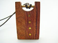 Handmade Wood Pendant with Brass Accents (Brass Buttons). $70.00, via Etsy.