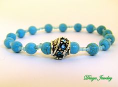 Turquoise and Glass Charm Bracelet