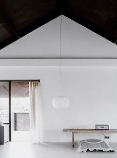 """Glo-ball"" broadcast lamp by Jasper Morrison. // minimalist black and white interior"