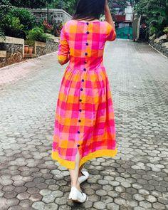 Pink and yellow checks cotton dress by Threeness Cotton Frocks, Cotton Gowns, Cotton Dress Indian, Cotton Long Dress, Dress Neck Designs, Designs For Dresses, Mode Turban, Ikkat Dresses, Kalamkari Dresses