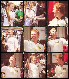 Rupert Grint and the Olympic Torch. He looks good with short hair...of course he always looks good.