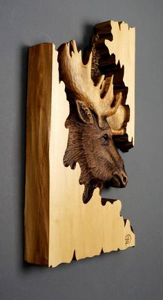 Moose Carved on Wood Wood Carving with Bark Hand Made Gift Wall Hanging for the moose lovers Rustic OOAK Gift for a Hunter Cabin Decoration FREE SHIPPING TO CANADA AND UNITED STATES For delivery to outside of North America the price is indicated for each country in the SHIPPING and POLICIES section Dimensions: 10,5 X 16,5 X 1 1/4 (27cm X 43cm X 3cm) The sculpture in the listing photo, is the same unique sculpture that you will receive Like all my carvings, it is a unique piece, made...