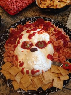 Skull made with cream cheese , shrimp and chili sauce