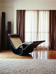 How on earth do you get in and out of the chair while the thing is rocking?   Oscar Niemeyer.