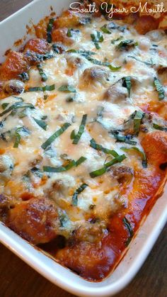 Bubble Up Pizza with actual pizza dough (not biscuits), Italian sausage, gobs of mozzarella, marinara sauce and fresh basil! It's like a deep dish pizza in a casserole!