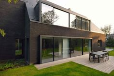 Architecture firm have designed the renovation of a two-storey white brick villa into this contemporary black house. Architecture Details, Modern Architecture, Villas, Contemporary Cabin, Glass Structure, Wood Staircase, Black Brick, Types Of Houses, Black House