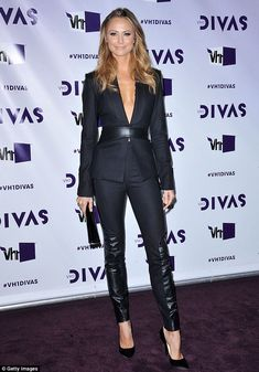Now THIS is how a woman wears a suit! Stacy Keibler was dressed to impress in her black trouser suit