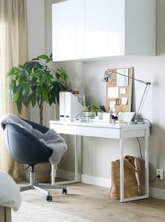The space saving, sleek, white BESTA BURS desk can help you stay organized in your work space and looks good doing it.