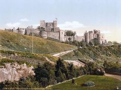 Victorian Colour Photo of Dover Castle from Connaught Park, Kent, England, United Kingdom. Derived from a United States Library of Congress photomechanical print dated ca. 1890-1900. Henry II's Keep (Great Tower) above Inner Bailey and King's Gate. Constable's Gate and Western Outer Curtain Wall. Park opened by Duchess of Connaught 1883. English Heritage Listed Building and Scheduled Ancient Monument. Medieval History, Travel, Tourism, and Vacation. See: http://www.panoramio.com/photo/87855668