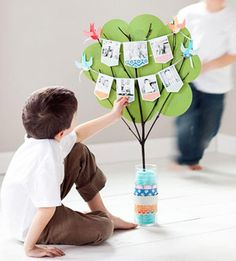 """Cute idea for displaying photos of students, possibly on a bulletin board? Birds hold """"clothesline"""" made of yarn with pictures hanging on it. we could have a tree for each family!!!"""