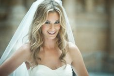 Casual but stunning curled wedding hair with veil