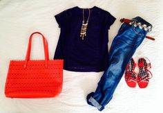 Slouchy boyfriend jeans and a pop of color with the perforated tote make this the perfect look for running errands.