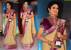 """Sridevi attended the GR8! Women Awards in Hyderabad, where she was felicitated for her work in cinema, wearing a sand and purple colored sari. Not that we're fans of the outfit but what did her worse was the heavy makeup and concealer issues. Oh, and how can we not mention the lens? Talk about an instant Nagin flashback! 'Eye-Caramba!"""""""