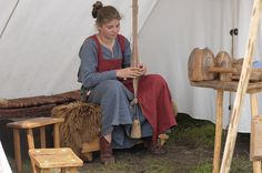 Tablet weaving using a vertical weighted warp (Wolin Festival Poland, 2011)