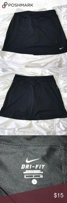 Nike dri-fit skirt skort spandex shorts under Black skirt- I used it for a golf tournament. Straight skirt- good for Tennis too! Nike Shorts Skorts