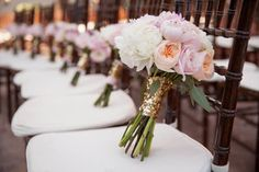 Peony wedding bouquets in shades of blush, ivory and lavender wrapped in gold glitter ribbon for an outdoor wedding. | The Stillwell House in Tucson, AZ