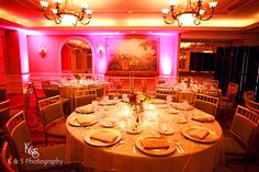 pink uplighting adds that WOW factor to a wedding reception