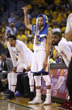 Stephen Curry of the Golden State Warriors looks on from the sideline against the Cleveland Cavaliers in Game 1 of the 2017 NBA Finals at ORACLE...