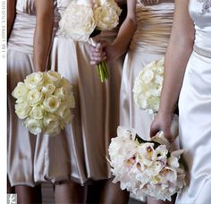 The bridesmaids dressed in champagne- colored dresses with ruching and a trendy bubble hem by Dessy. Each bridesmaid carried a different bouquet in a single cream-colored bloom, ranging from roses, peonies, ranunculus, lisianthus, tulips, cymbidium orchids, hydrangeas, and mini calla lilies