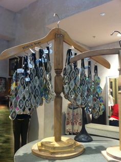 Anthropologie store. What a great idea making a jewelry hanging stand out of a coat hanger.
