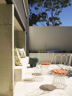 I personalised this outdoor space for my client with interesting furniture and customised cushions...such an easy way to tailor the space...by Stacey Kouros Design.