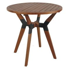 An angled leg base with gray metal connectors gives the Outdoors Interiors 30 in. Round Patio Bistro Table its modern appeal. Outdoor Dining Furniture, Outdoor Decor, Yellow Houses, Transitional House, Wood Surface, Picnic Table, Wood Table, Stool, Table Settings