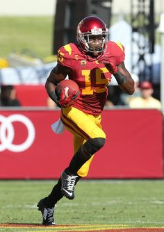 7cfd6808b2e Wide receiver Nelson Agholor #15 of the USC Trojans carries the ball  against the Colorado
