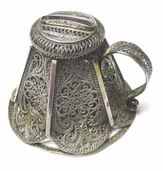 6647. Antique Russian Silver Money Box  A pretty little filigree silver money box with a hinged lid and side handle. The top has a slot for coins to be posted and at the front there a little hinged catch which can be secured with a padlock (not supplied).