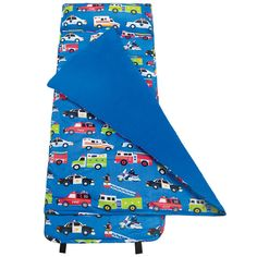 Is your little person going to school or daycare? Or maybe he spends some time at grandmas or at the babysitters? Does he rest, take a nap, or watch TV and like to snuggle? This modern sleeping bag or sleep sack has an attached blanket and pillow. It rolls right up for easy and fast clean up. What is even better? I will customize and personalize it for you with a monogram or his name!  A festival of heroic lights! This playful pattern pays tribute to our valiant fire, police, and rescue men…
