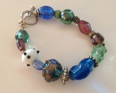 Vintage Sterling Silver Lampwork Glass Bead Bracelet by VintageVelvetBox on Etsy