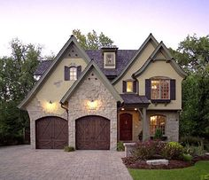 European Cottage... Usually despise the homes with the garage stuck out in front of the actual home and the main focus of design... But I like this! Enough going on to enjoy besides garage doors.