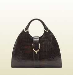 Gucci stirrup brown crocodile top handle bag. It must be ordered and costs $26,500. Yummers. SO lady-like.
