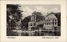 1940 - 1945. View on café-restaurant Lido at the Leidsekade in Amsterdam. In the foreground a gondola in the Singelgracht. In the background the Leidsebrug and the American Hotel. After a successful run as a café-restaurant in the 1950s, the Lido served between the mid-1960s and the mid-1970s as society of the Amsterdam Studenten Corps. In the two decades following it gradually fell into disrepair. Photo Vigevano. #amsterdam #1950 #lido