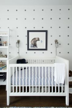 The room is so calming that even an adult might be tempted to curl up into the crib... if only they fit. | Wave Crib Sheet via #serenaandlily