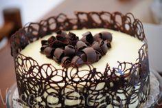 Red Velvet Single tear Wedding Cake, White chocolate ganache topping with dark chocolate swirls and a dark chocolate lace border.
