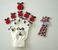 Semi-homemade puppets are quick and easy. The bugs are felt stickers. The giraffe was made from animal print felt.
