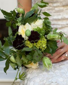 This lush bouquet boasts English garden roses, green dianthus, passion vine, hydrangeas, and accents of chocolate cosmos. Geranium foliage is wrapped around the stems