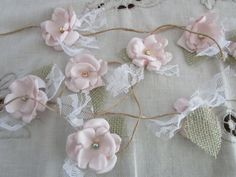 Check out this item in my Etsy shop https://www.etsy.com/listing/259428550/fabric-flower-garland-rustic-wedding