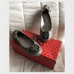 Tory Burch Reva Vintage Metallic Leather Flats Reva flats - pewter. I really wanted to love this shoe but it is just a tad too small for me. I wear a size 7-7 1/2 and this fits more like a 6 1/2-7. Worn only once. In excellent condition-like new. Tory Burch Shoes Flats & Loafers