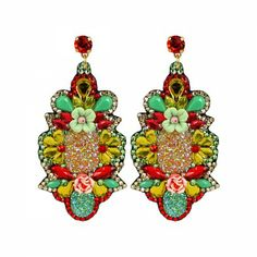 Lacrom Store || Claudia Baldazzi, Accessories, Flower Power Earrings  Flower power medium-large silhouettes made with resins and Swarovski golden shadow, peridot and hyacint, with cabochon glitter, fimo flowers and ceramic, golden brass details and Swarovski hyacint pins.