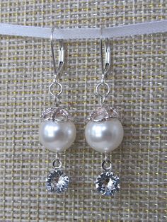Check out this item in my Etsy shop https://www.etsy.com/listing/532260435/classic-swarovski-crystal-and-pearl-drop