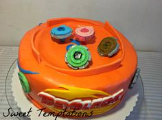 Beyblade cake - Beyblade arena with Beyblades. It`s all fondant and gumpaste.