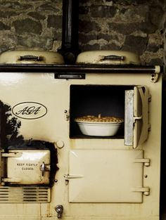An Aga stove -- valscrapbook: rusticmeetsvintage; photo by Andrew Montgomery, Farmhouse Cookbook