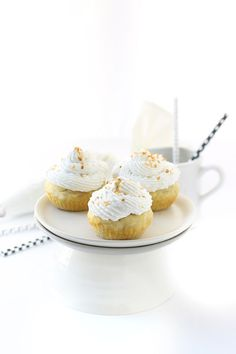 healthy vanilla cupcakes made with a delicious gluten-free flour blend and topped with a fluffy and dairy-free coconut cream frosting.