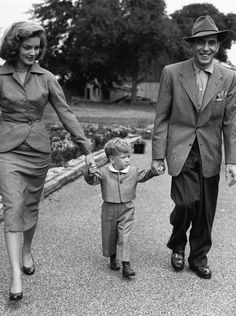 Humphrey Bogart and Lauren Bacall escort their son Stephen through Worton Hall Studios, 1951