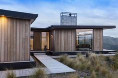The building is predominantly clad in vertical cedar, which has been oiled and left to grey. The natural cedar palette has been carried on through the surrounding decking and board walks, ulitising heart macrocarpa.