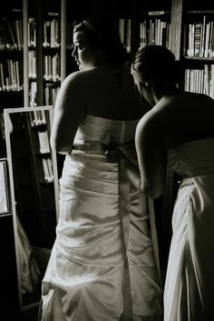 Sister Helping The Bride Into Her Dress Weddingphotography Texaswedding Bridal