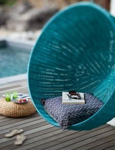 Teal poolside hanging chair // want #furniture_design